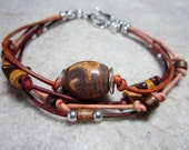 4 strand leather bracelet in browns