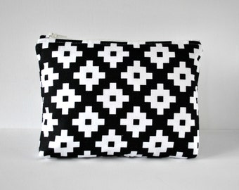 Woman's cosmetics make up pouch travel bag in geometric cross print in black and white in large.