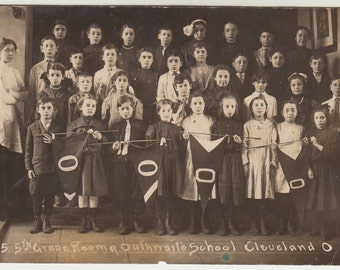 Vintage/ Antique postcard photo of a group of children and their teacher in a class picture