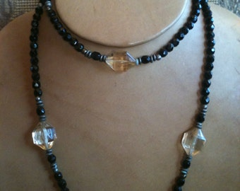 Vintage Woman 36 Inches Long Necklace Lucite Black and Light Carnary Beads