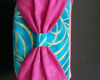 Mini Bow Clutch - Turquoise with Gold Swirl Pattern, Multi-color Striped Lining, Magenta Bow and Neon Pink Zipper