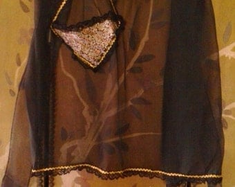 sheer black apron with gold and black trim detail