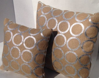 """Natural beige burlap pillow with silver metallic rings on both sides, in 3 sizes: 10, 12"""" & 16""""."""