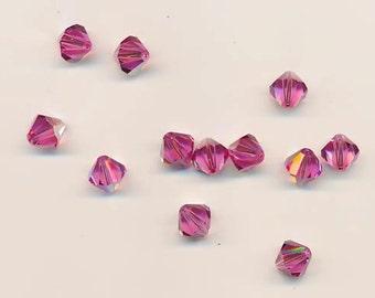 Twelve sparkling Swarovski crystals in the discontinued shape 5301: 10 mm - rose AB