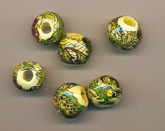 Six vintage large-holed ceramic beads - about 27 mm - complex design on a pale yellow background