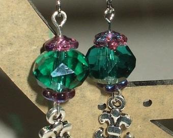 Teal cross earrings.