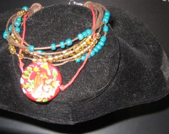 Painted Cardinal Ceramic Bead on Red and Brown Hemp Bracelet