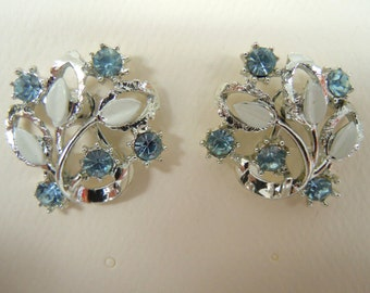 Blue Crystal Rhodium Plated Screw On Earrings With White Leaves