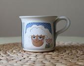 Large tea mug with smiling sheep