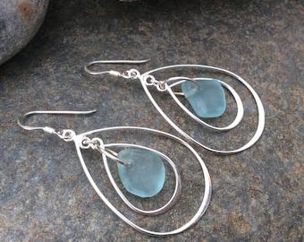 Sea glass jewelry,  Blue sea glass dangles within two sterling silver teardrops