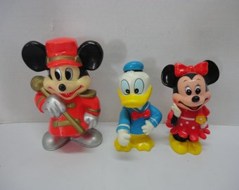 Lot of Three Vintage Rubber Plastic Disney Minnie Mouse And Donald Duck Coin Banks Drum Major Knickerbocker