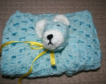 Crochet Baby Comforter Blanket With Teddy Bear Head. Measures 44cm square. Blue And White. Yellow Ribbon. Plastic Eyes.