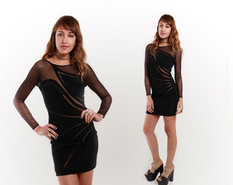 Gorgeous solid and mesh Long Sleeve Black Dress Kelly Rowland style