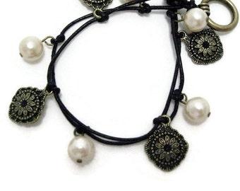 Pearl Brass Charm Bracelet black leather medallion charm shell beadwork handmade