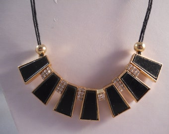 Bib Necklace with Gold,  Black and Clear Rhinestone Pendants on a Black Cord Chain