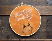 Humorous Cat Art, Attack Cat on Duty, Hoop Art, Embroidery, Embroidered Art, Textile Art, Hand-Stitched, Handmade Embroidery, Black Cat