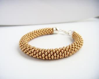 Gold beadcrochet bracelet, cuff, snake, matte satine gold