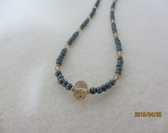 Simple, delicate black and gold necklace.