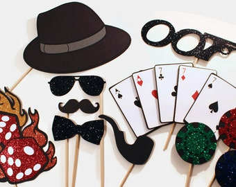 James Bond Themed Photo Booth Props - Photobooth features oversized deck of cards, glittered dice on fire, and more...
