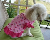 Dog Clothes, Puppy Dress in Butterfly Motif on a Pink Background with Hot Pink Butterfly Sleeves and a frily ruffle.