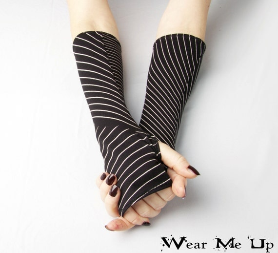 Black and White Striped Fingerless Gloves Made from 30% wool these fingerless gloves are soft and not itchy designed for one size to fit all.