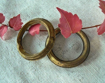 "Two large brass rings : 2,8"" diameter"