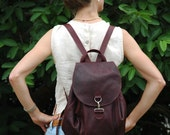 real leather, practical yet elegant satchel / backpack in natural redish brown