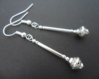 A pair of pretty tibetan silver  dangly earrings.