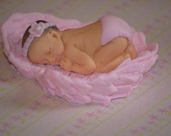 Baby girl sleeping in Angel wings