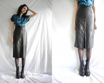 80's rocker black high waisted below the knee leather skirt.