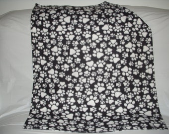 Doggy blanket - adorable white paws on black fleece with the same pattern on the reverse side.