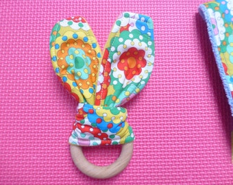 Natural wooden baby teether with retro 60s flower fabric