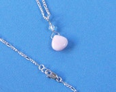 Pink Opal Pendant Necklace on Silver-Filled Figaro Chain