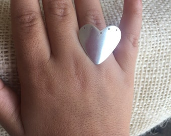 Holes-in-my-heart silver ring