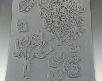 Fossillious an Unmounted stamp great for polymer clay and other crafts designed by Christi Friesen