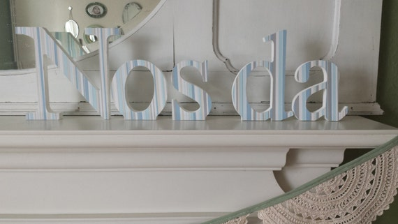 Pale blue Nos Da free standing wooden decoupaged letters. 15 cm high