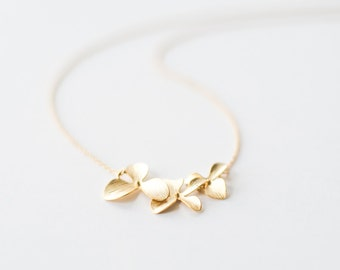 Delicate gold triple orchid flower necklace