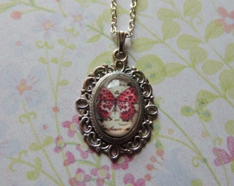 Pink speckled Butterfly pendant