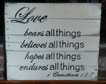 Love endures sign hand painted on rustic, reclaimed wood