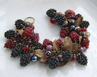 Glass lampwork bracelet with a lot of berries and bronze leaves. Deep red and black color.