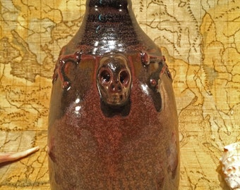 Red Iron Jug with sculpted skull