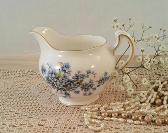 Vintage Royal Vale milk jug made from bone china in the 1950's with blue forget me not pattern.
