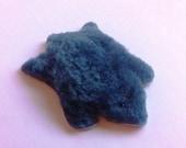 Miniature bearskin rug, made from sheepskin.