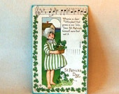 Vintage Saint Patrick's Day Postcard: Girl Basket of 4 Leaf Clovers, Embossed