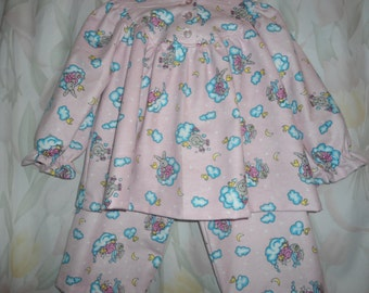 Size 2 Girls Pajama with gray rabbits riding on turquoise an white clouds on pale pink background.