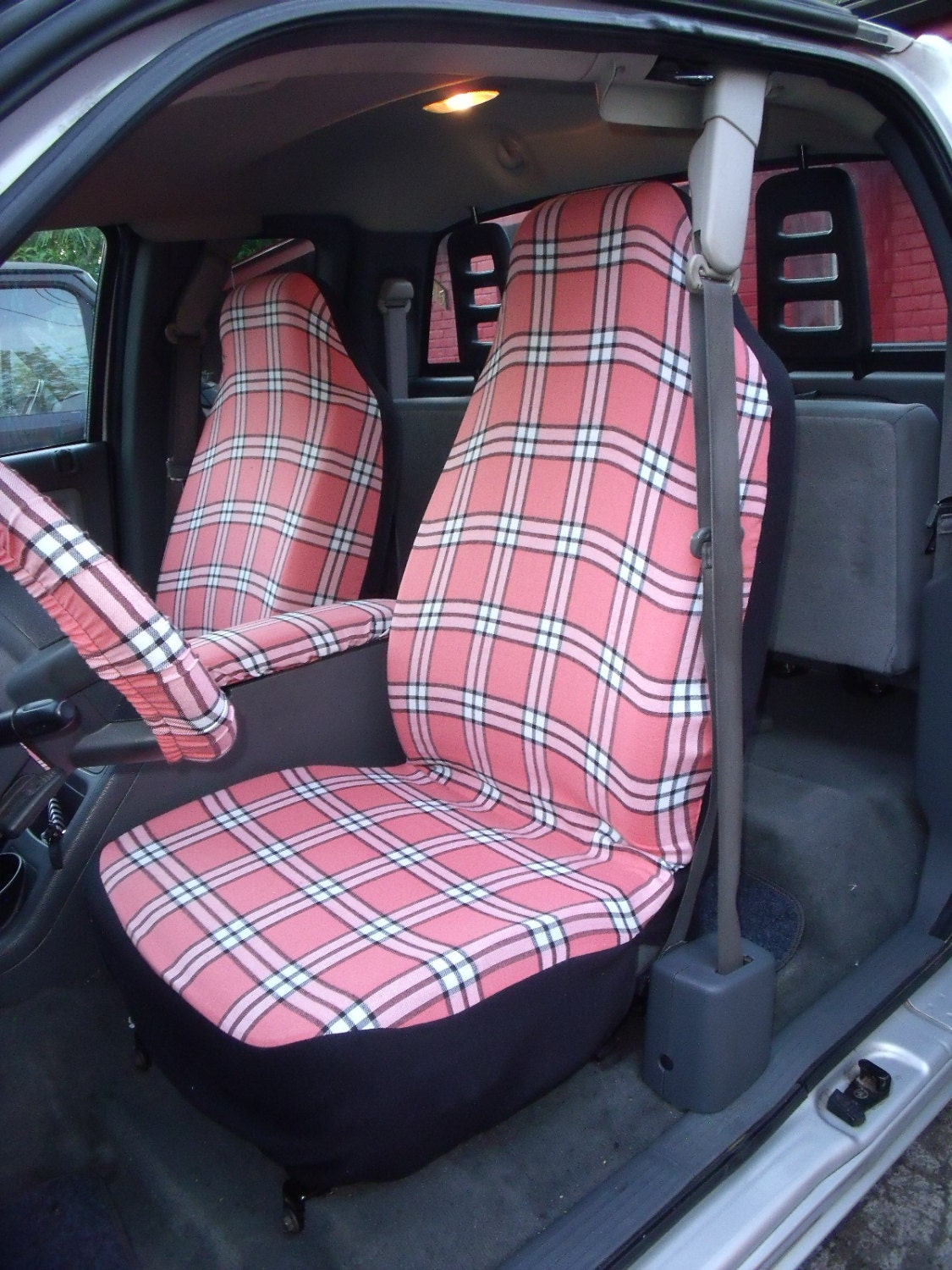 1 set of pink plaid print seat covers and the steering wheel. Black Bedroom Furniture Sets. Home Design Ideas