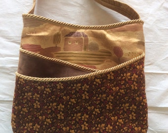 Multi-Look Bag in golds, browns, & burgundy.