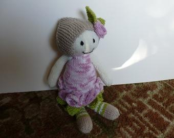 Knitted rose flower dolly