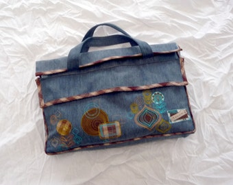 Bag  laptop, in clear jean with design embroidery