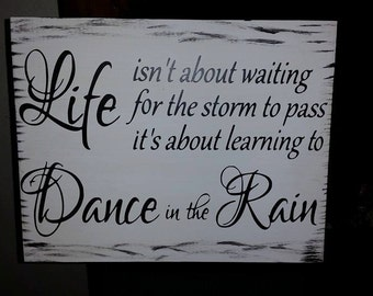 Beautiful 1' x 2'  Life isnt about waiting for the storm to pass Wooden Sign
